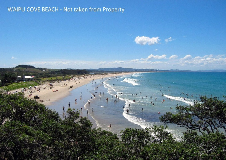 Waipu Cove, an hour and a half north from Auckland's CBD.  Beautiful white sandy surf beach.  North Island, New Zealand.