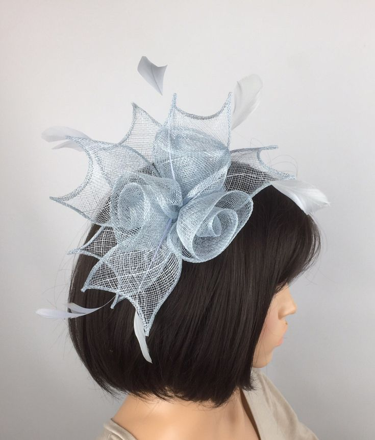 A personal favourite from my Etsy shop https://www.etsy.com/uk/listing/485721331/pale-blue-fascinator-baby-blue-comb