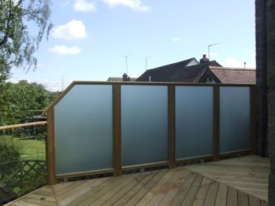 Glass privacy screens and wind breaks.