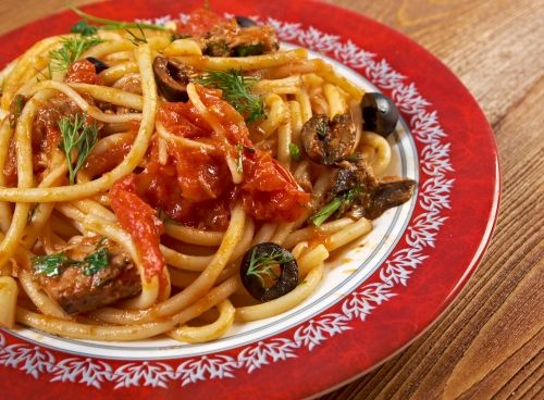 Deliciously spicy Italian sausage mixed with Kalamata olives, capers and tomatoes poured over pasta.