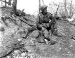 Korean War- An American soldier with a Russian made Degtyaryov machine gun (light machine gun firing the 7.62×54mm cartridge)