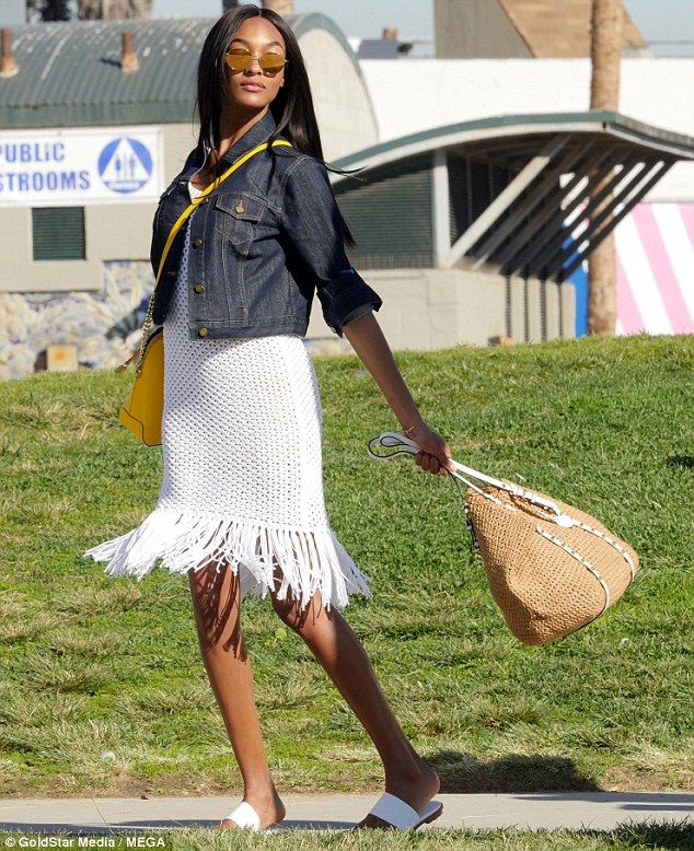 Twice the fun! Jourdan accessorized with a tote and a large yellow handbag...