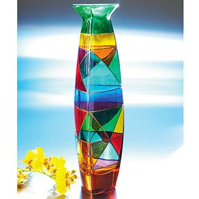 What better way to liven up a drab room than with this Crystal Coloratura Bud Vase? Because it's a bud vase, it doesn't take much filling for this to stand out: it could even look beautiful with a single bamboo stalk or a small array of white buds. From The Smithsonian Store, $98.