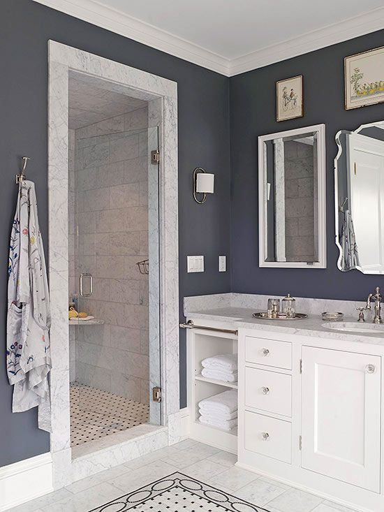 Even+the+smallest+bathroom+can+accommodate+bounteous+style.+Though+diminutive+in+dimension,+this+walk-in+shower+makes+an+impact+thanks+to+its+marble+door+frame+and+tiled+interior,+which+are+highlighted+by+charcoal+walls.+Bathroom+floor+tiles+repeat+inside+the+shower+to+visually+link+the+two+areas.