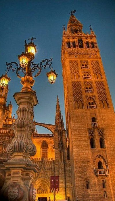 La Giralda, Sevilla, Spain (by R.Duran)           Such beautiful lighting in this picture.