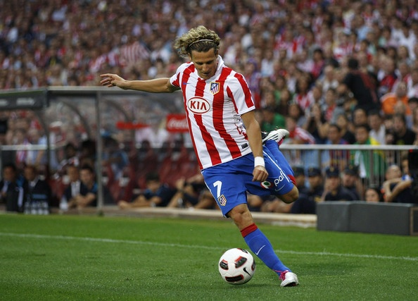 Diego Forlan, a Great Soccer Player with a hot hairstyle. one of the outstanding players in the 2010 World Cup.
