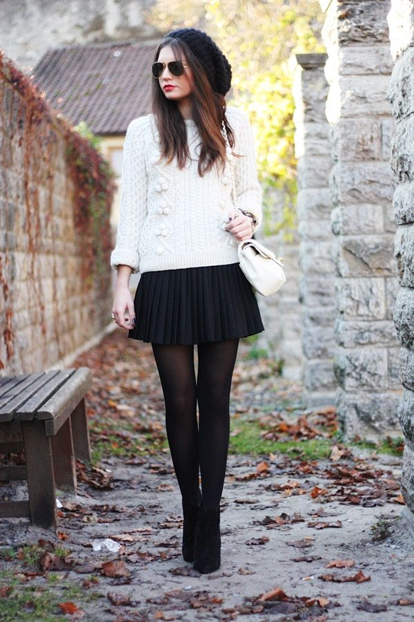 Super chic fall outfit--fisherman's sweater over pleated skirt and tights. But it's definitely the giant beanie that pulls the whole thing together!