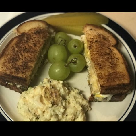 Leftover Thanksgiving turkey with grilled onions, melted Swiss cheese,and mayo. Served with leftover potato salad and dill pickle spear yum 😋