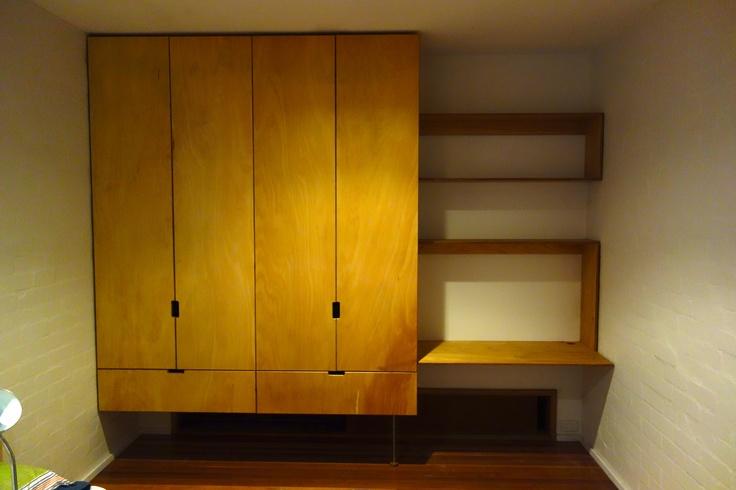 floating plywood wardrobe/study area.
