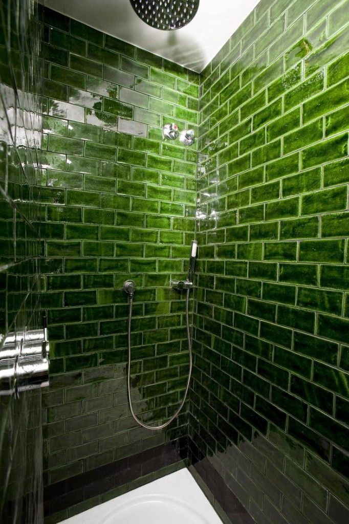 Rich green glass subway tile in the shower