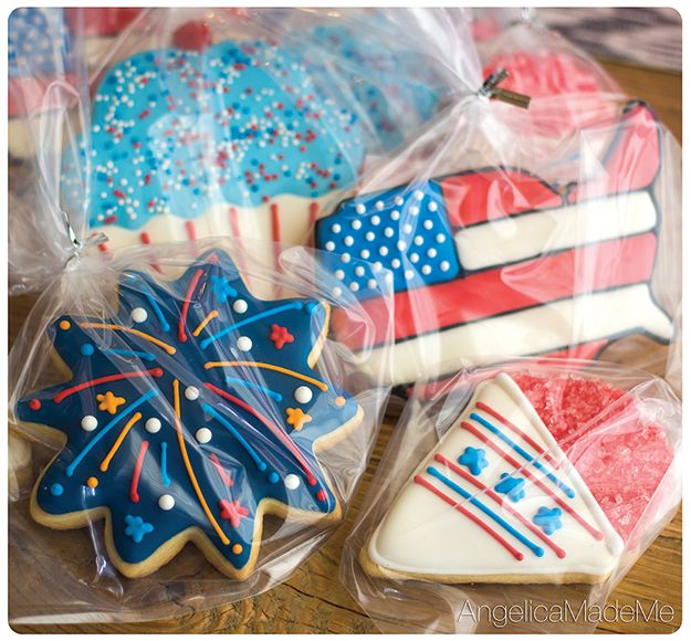 4th of July Decorated Sugar Cookies. Red, white & Blue  snow cones, cupcakes, USA flags and fireworks.