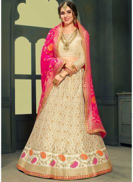 5e5d9fa7ca Shop Online Jacquard Silk Woven Lehenga Choli in Cream Color. Jacquard silk  lehenga in cream color is designed with floral zari woven motifs all over.