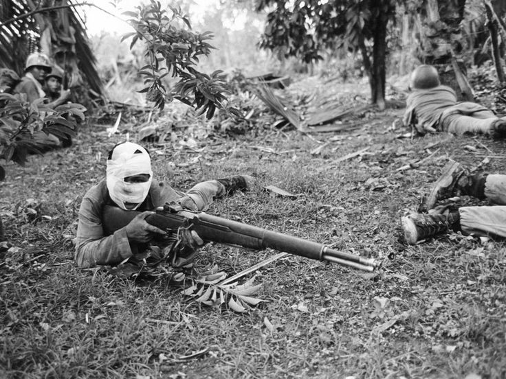 A wounded vietnam solidier using his gun.