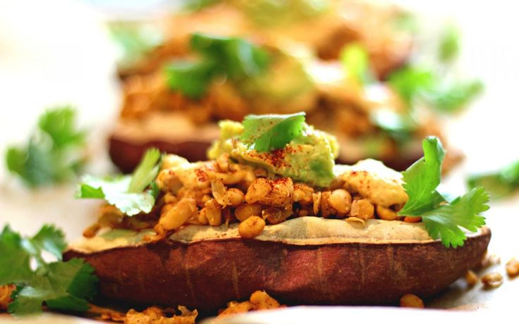 Loaded baked sweet potatoes with nacho cheese and tempeh