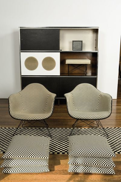 Cabinet and chairs by Charles Eames, Upholstery by Alexander Girard.