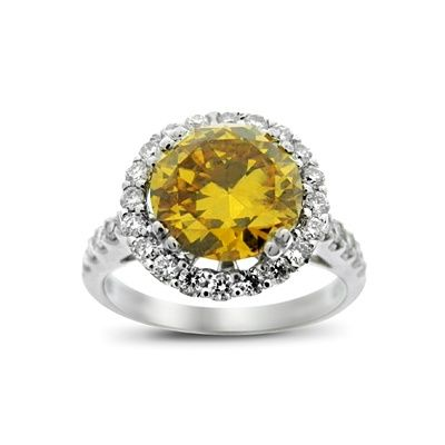 For a Carrie Underwood inspired ring, look to this Brilliant Cut Natural Fancy Deep Brownish Orange Diamond Ring 2.40ct from Hatton Jewels