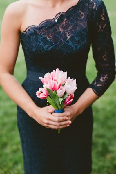 pink tulip bouquet with midnight blue bridesmaid dress