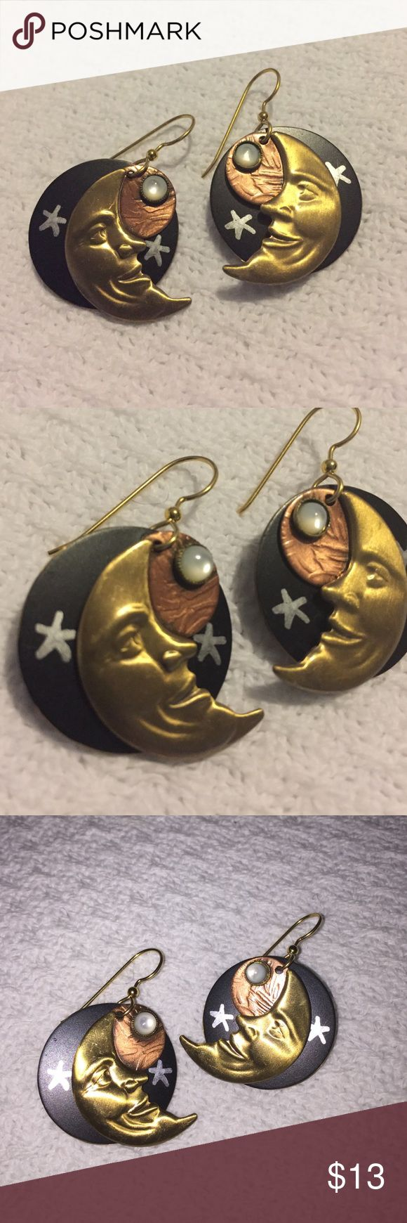 """Handcrafted Half Moon Planet Galaxy Stars Earrings Handcrafted Moon Planet Galaxy Earrings. Handmade using different metal tones in gold, copper, and/or brass. Highly detailed Earrings that are for pierced ears. Beautiful gold tone half moon raised face with a moonstone setting on a copper planet disc that also sits on a painted black night disc w/silver painted stars. Earrings Measure 1 1/2"""" L x 1"""" W. Great condition, like new! Jewelry Earrings"""