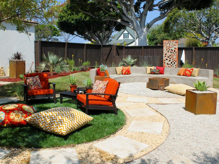 Exceptionnel Fire Pit Design Ideas : Home Improvement : DIY Network   The Hefty Metal Fire  Ring Is Half Encircled By An Even Heftier Concrete Seating Area.
