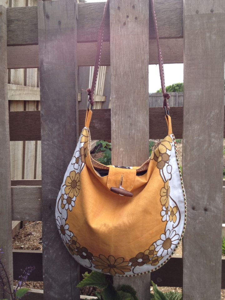 Beautiful linen tea towel bag with reloved handles.