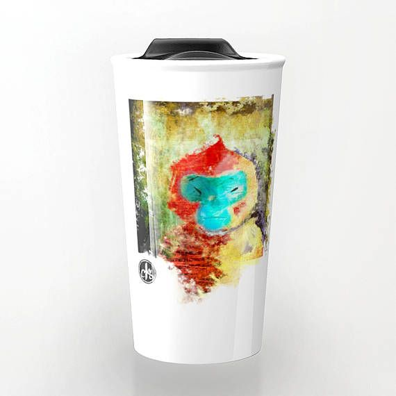 A curious and mischievous monkey painting, staring back at you. This mug matches a fun personality! The mixed muted and bold colors match an Asian style, and the textures reflect an industrial city look.  Enjoy your coffee, tea or hot chocolate in this ceramic travel mug with unique artwork.   WHAT YOULL RECEIVE: --------->One unique ceramic travel mug with hard durable plastic lid! --------->Double walled ceramic mug that keeps your drink hot! --------->Microwave and dishwasher saf...