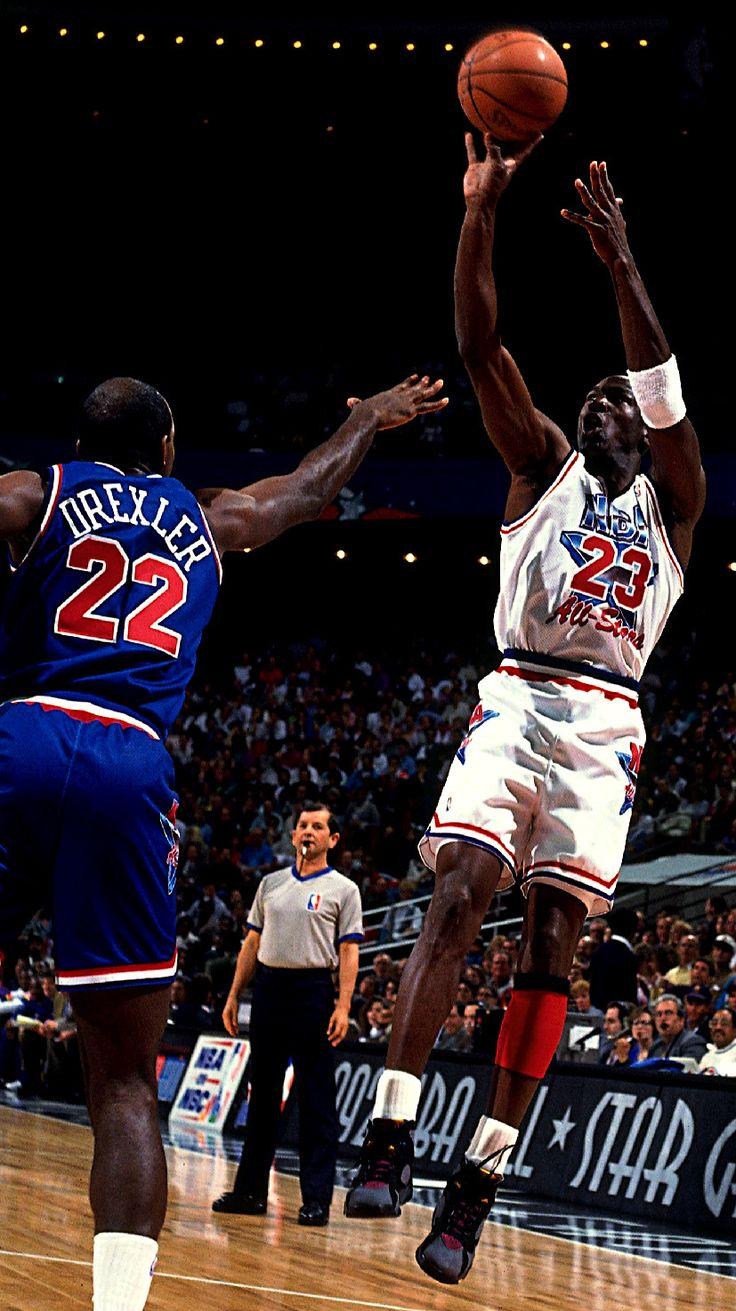 Michael Jordan Wearing  Hakeem Olajuwon and Michael Jordan  Mike Gets It Up  Over Drexler 759a61875