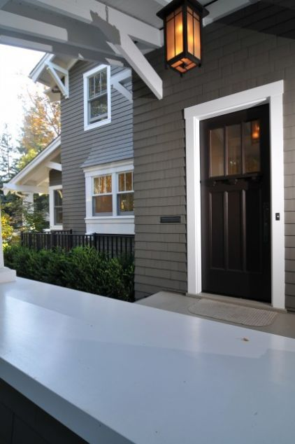 This is the exact exterior paint color I want for my new house. Love the white trim and black door too!