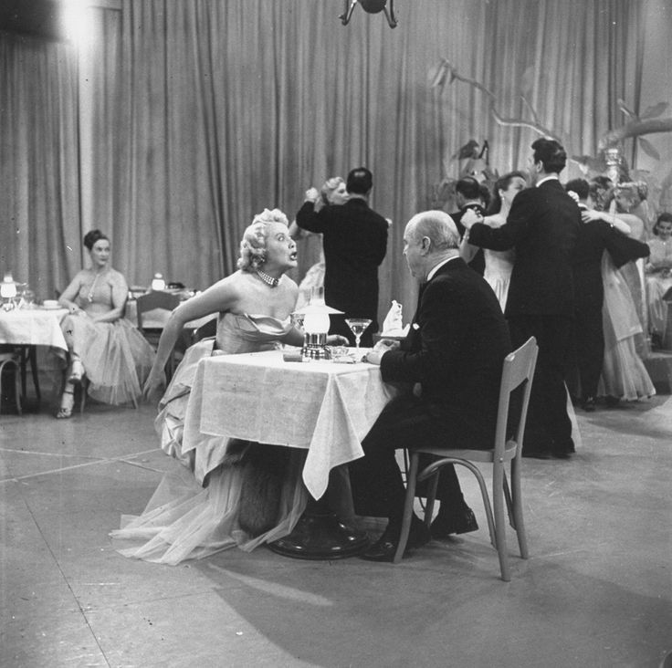 "Vivian Vance and William Frawley (Ethel and Fred Mertz) filming a scene on the Tropicana nightclub set. | 21 Wonderful Behind-The-Scenes Photos Of ""I Love Lucy"""