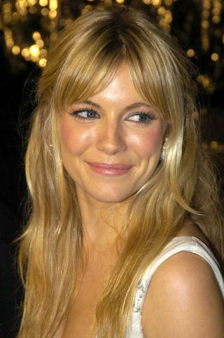 Long hairstyle with bangs that we LOVE! Sienna Miller's gorgeous, swooping, face-framing bangs FTW.