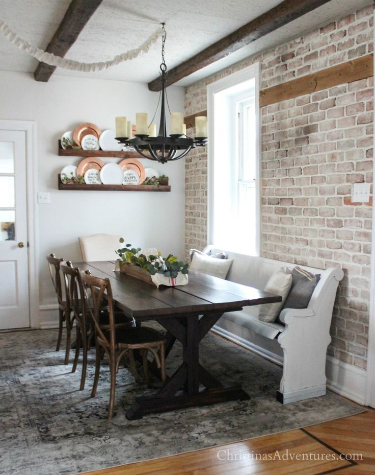Vintage inspired farmhouse dining room makeover reveal - love the brick wall and wood beams!