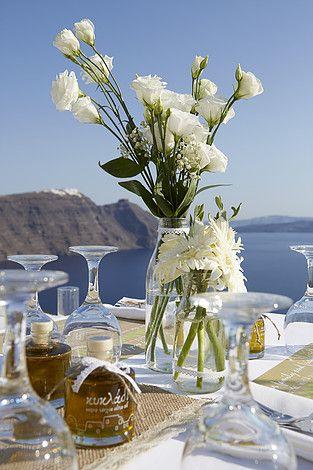 white wedding decoration lisianthous flowers olive oil wedding gifts beautiful wedding dinner set up glass milk bottles decor santorini