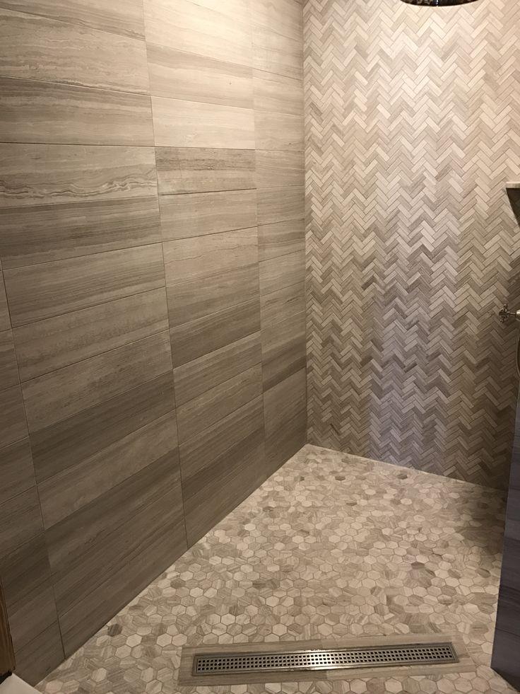 Linear drain!  Love that CurbLESS appeal!!Wooden beige marble. #architect #bathdesign #clinestone #clinemarble #construction #hex #hexagon #decorator #designers #focalwall #gardencitytile #homedecor #hamptonsbath #woodenbeige #herringbone #greige #transitional #naturalstone #interiordesign #instock #longislandtile #stevencline #westocktile #mosaictile #marble #tile #interiordesign #stevencline #greybeige  #greytilefloors #greytile #focalwall