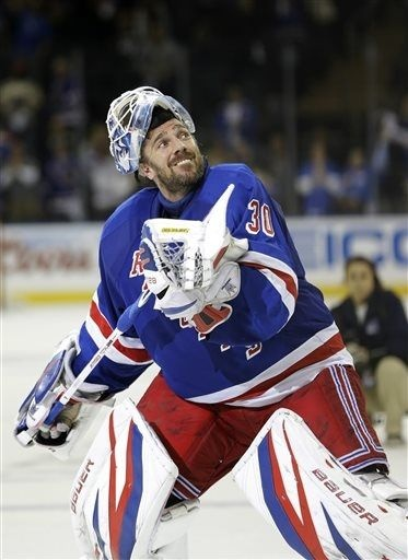Henrik Lundqvist of the Rangers celebrates after forcing a game seven against the Capitals 5-12-13