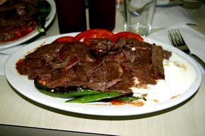 Iskender Kebab- Bursa, Turkey.   İskender kebab is one of the most famous meat foods of northwestern Turkey and takes its name from its inventor, İskender Efendi, who lived in Bursa in the late 19th century. It can be assumed to be derived from a verticalized version Cağ Kebabı, from Erzurum.   http://en.wikipedia.org/wiki/Iskender_kebab