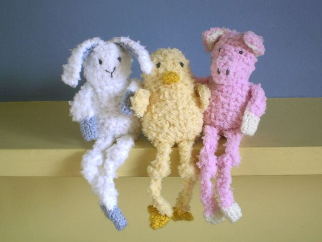 Baby-Long-Legs-This pattern is available as a free Ravelry download. These little creatures have bean bag bodies to help them sit up and long dangly legs. They are about 10cm tall (not counting their legs) and instructions are included for knitting a duckling, a pig and a bunny