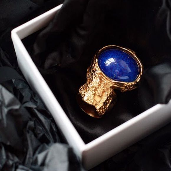 Rare YSL Arty Ring- Blue Gold RARE and discontinued iconic Arty Ring from Yves Saint Laurent. 100% AUTHENTIC. Brand new condition. Original box and YSL dust bag. Deep blue stone set in gold textured ring. Size 5. Color: Lapis. The one and only cocktail ring you will need! Better price available through pp. Yves Saint Laurent Jewelry Rings