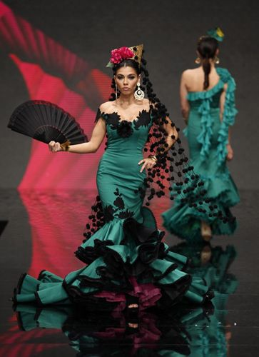 Models present creations by David Alvarez & Purificacion Ramos during the International Flamenco Fashion Show SIMOF in the Andalusian capital of Seville Feb 2, 2012.