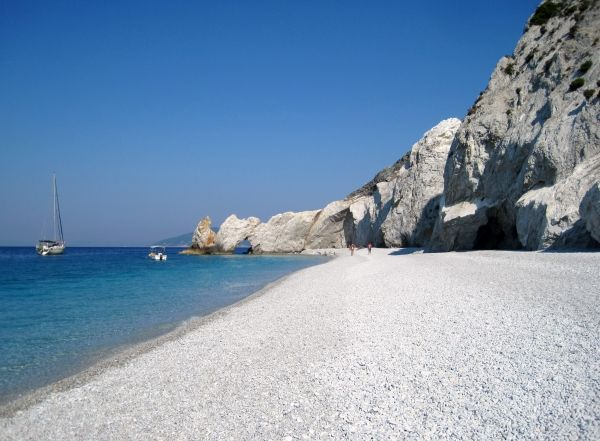 The famous beach of Lalaria with the white pebbles