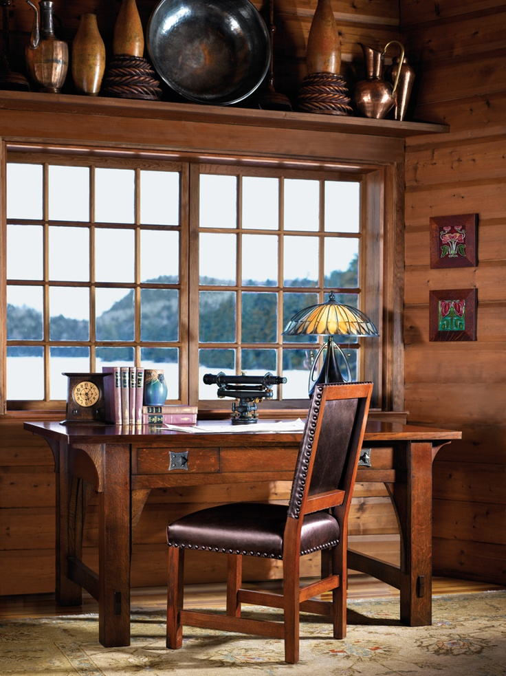 Craftsman cabin by the lake with Stickley Mission library table.
