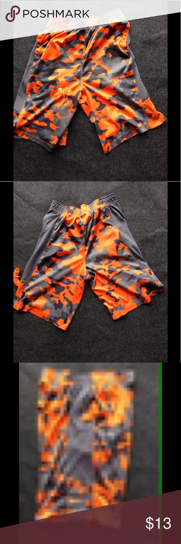 "RUSSELL boys sport shorts RUSSELL boys sport shorts. Orange/gray camo design. Elastic waist, side seam pockets. Dri Power 360 . Good condition, slight pilling from wear hardly noticeable when wearing. Measurements laying flat: Waist 12"". Inseam 9"". Out seam 18"". Leg opening 10 1/2"". Front rise 11"". Back rise 14"". Hips 16"" Russell Athletic Bottoms Shorts"