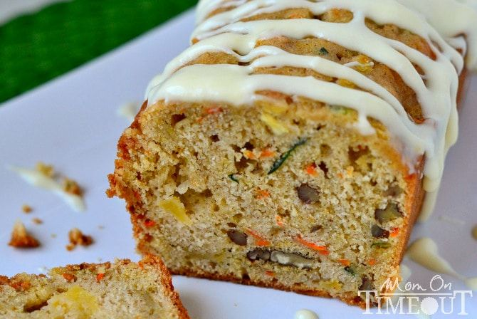 This Carrot Zucchini Apple Bread recipe is incredibly moist and flavorful! Vibrant colors from the carrot, zucchini, and apples makes this bread irresisitble! Sure to be a new favorite! Author: Trish - Mom On Timeout Recipe type: Bread Serves: 32 servings Ingredients 1 cup unsalted butter, melted 2 cups granulated sugar 3 eggs, room temperature ¼ cup fresh orange juice 1 tbsp vanilla extract 3¼ all-purpose flour ½ tsp salt 2½ tsp baking powder ¾ tsp baking soda 1 tbsp cinnamon pinch of…