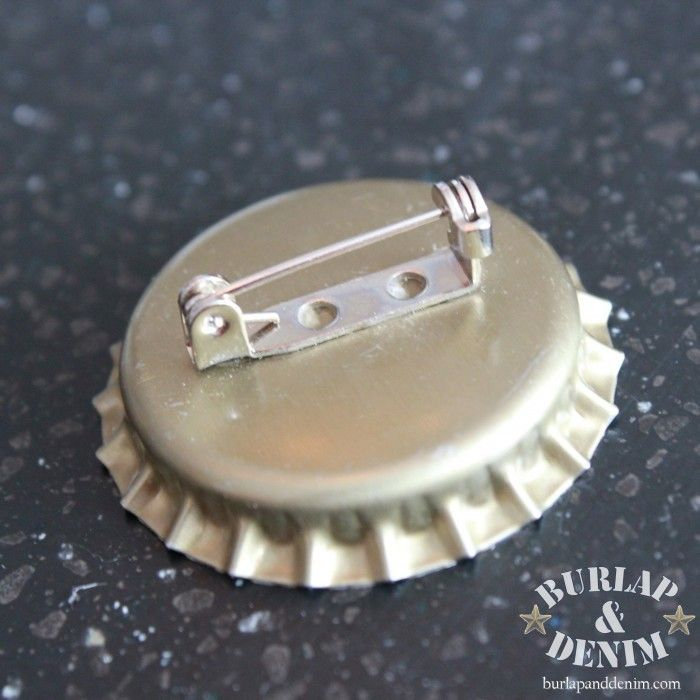 Add a pin on the back of a bottle cap so you can pin it on your shirt, sweater or girl scout vest!
