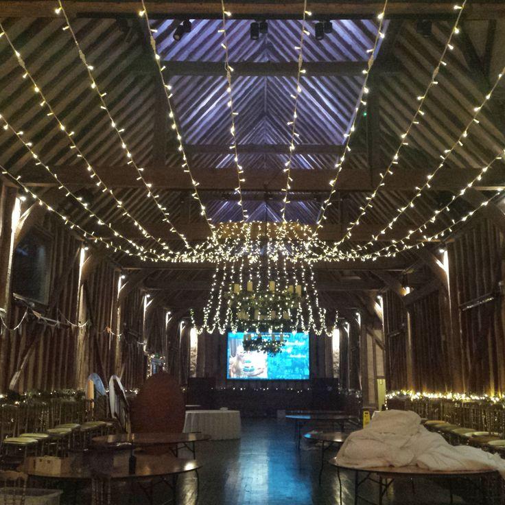 The Great Barn. A beautiful 12 string sweeping gathered canopy in true warm white fairy lights #weddinglighting #fairylights #barnwedding #berkshire #buckinghamshire #barnweddings @lillibrooke