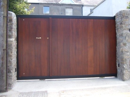 Sliding driveway gates with pedestrian access google for Wooden sliding driveway gates