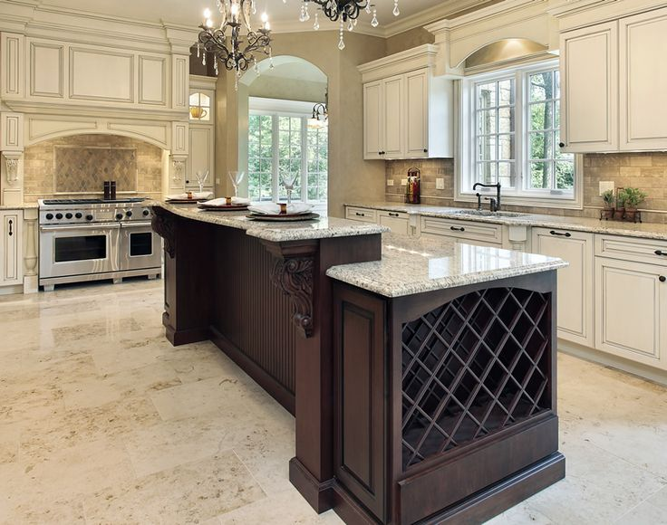 Custom crafted wood kitchen island with two levels and salt & pepper granite counter top.