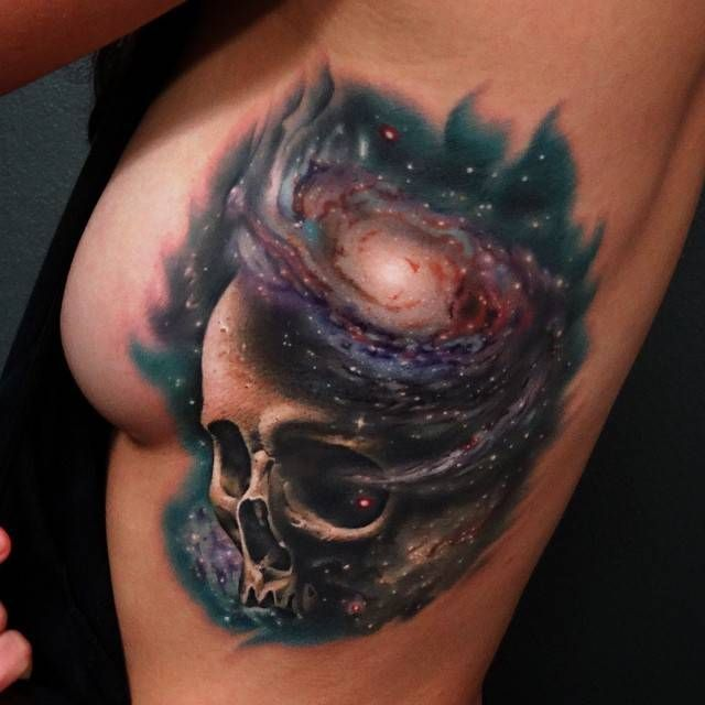 Side tattoo of a galaxy skull.Done by Andrés Acosta