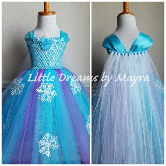Welcome to Little dreams by Mayra  This dress is a more affordable version of my original dress but it is just gorgeous, great quality and very pretty! Dress has two layers of turquoise tulle with 5 strands of turquoise glitter tulle and 10 plastic snowflakes around it, Straps of the dress are made with satin ribbon that you can tight in the back with a bow or knot, cape is made with white tulle, very very pretty, I dont think pictures show how gorgeous this dress is! your little one will…