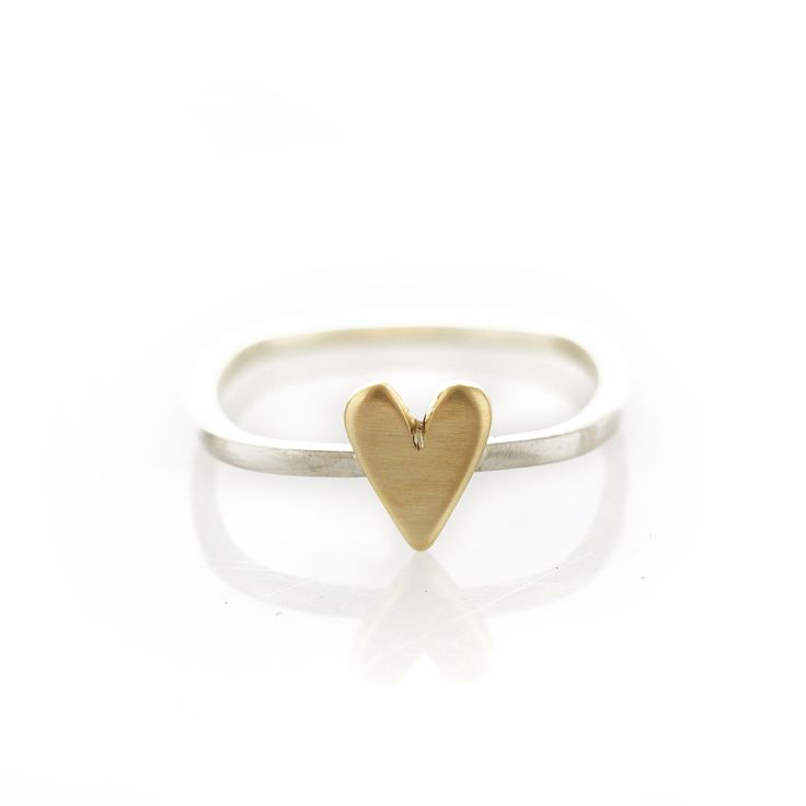 Dear Rae!   A thin square shaped sterling silver ring with brass heart.  Please check our info page for more details on ring sizes.
