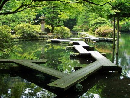 A temple garden bridge in Kanazawa, Japan.  The zigzags are to keep evil spirits from following you, as they are thought to only be able to move in straight lines.