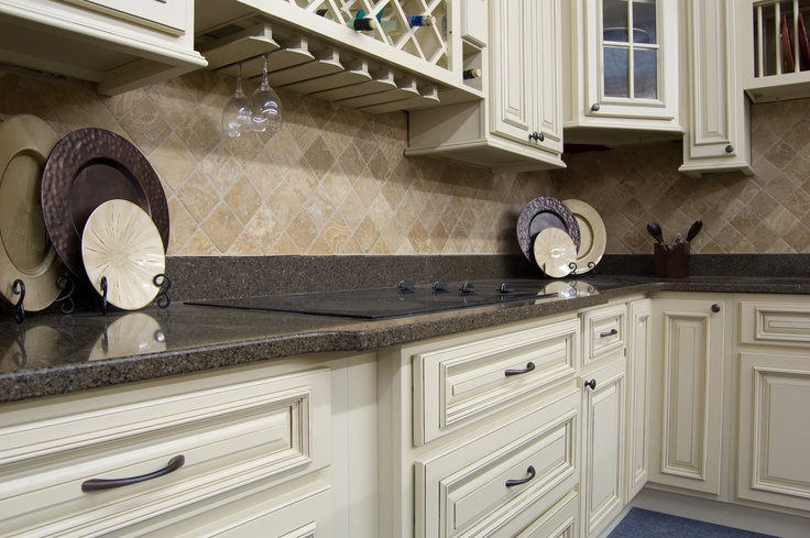 Heritage White cabinets with Quartz counter top and Travertine backsplash